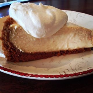 Eggnog Cheesecake with Rum Whipped Cream Recipe! wwwgenabellcom Christmas holidaydessertshellip