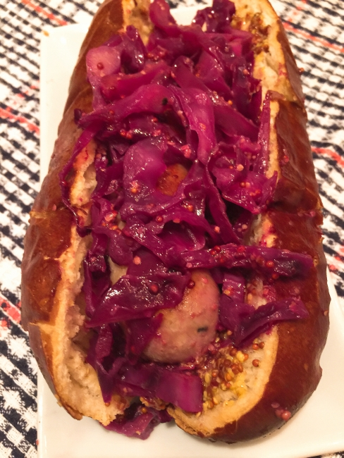 bratwursts-on-pretzel-buns-with-sauteed-mustard-red-cabbage-041-488x650