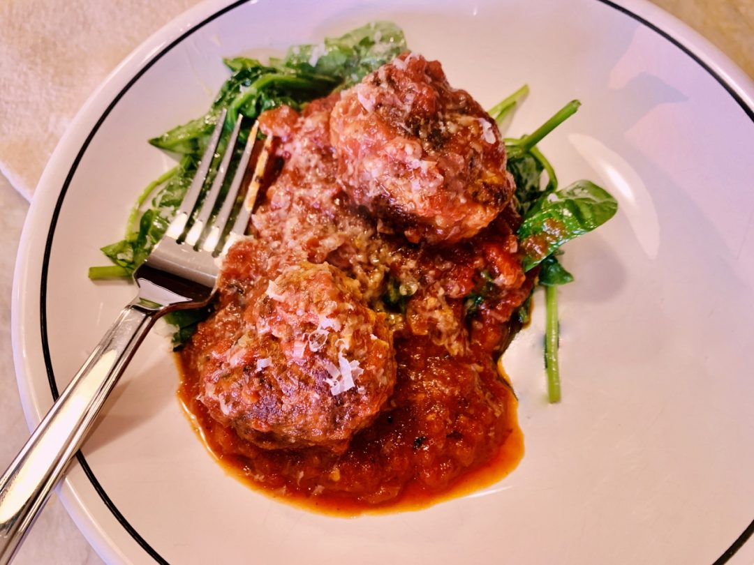 Meaty Fennel Meatballs Over Wilted Spinach – Recipe! Image 1