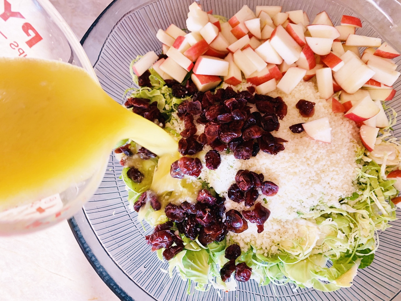 Shaved Brussels Sprouts Salad with Apples, Dried Cranberries & Pecorino – Recipe! Image 4