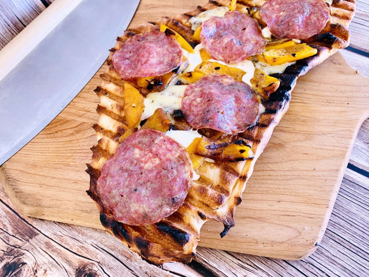 Grilled Flatbread with Truffle Cheese, Roasted Sweet Peppers & Salami – Recipe! Image 5